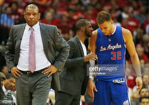 Head coach Doc Rivers of the Los Angeles Clippers waits alongside Chris Paul and Blake Griffin on the court in the second half against the Houston...