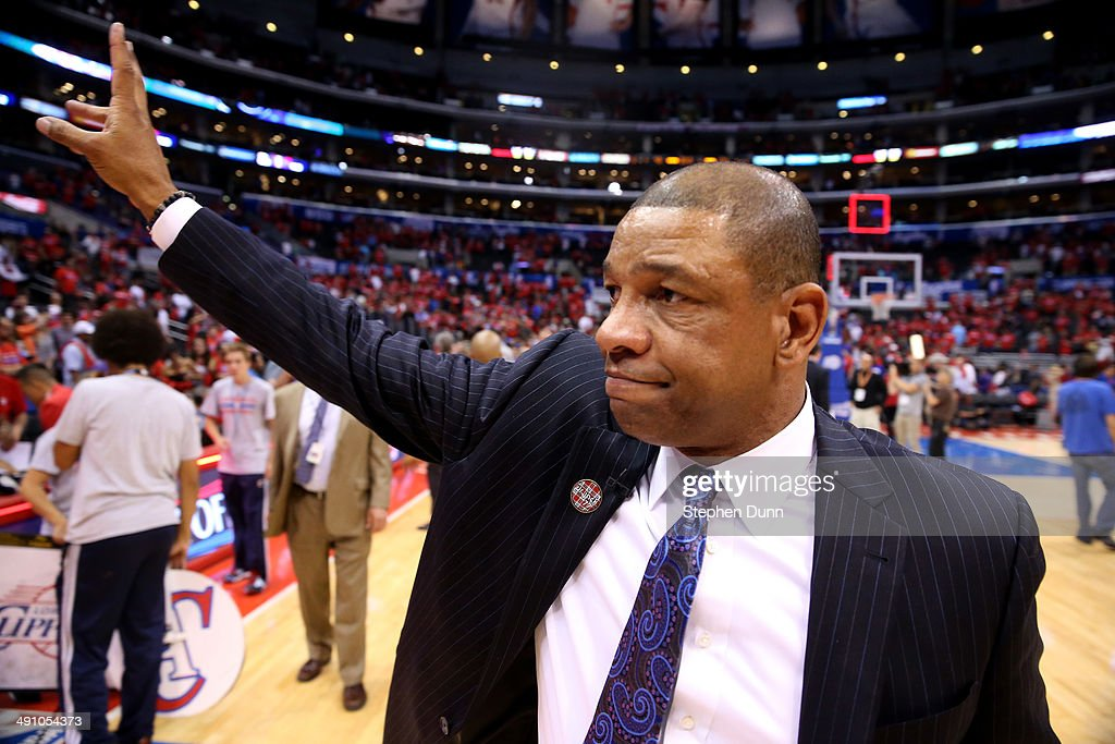 Head coach <a gi-track='captionPersonalityLinkClicked' href=/galleries/search?phrase=Doc+Rivers&family=editorial&specificpeople=206225 ng-click='$event.stopPropagation()'>Doc Rivers</a> of the Los Angeles Clippers waves to fans after the Clippers were eliminated by the Oklahoma City Thunder in Game Six of the Western Conference Semifinals during the 2014 NBA Playoffs at Staples Center on May 15, 2014 in Los Angeles, California. The Thunder won 10-98 win the series four games to two.