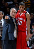 Head coach Doc Sadler of the Nebraska Cornhuskers points out some instructions to guard Toney McCray during a game against the Kansas State Wildcats...