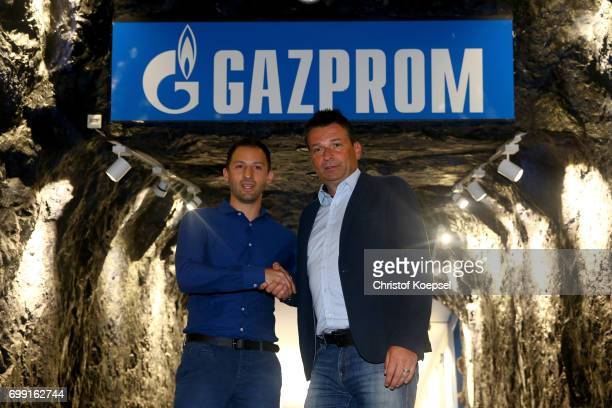 Head coach Domenico Tedesco and manager Christian Heidel of Schalke pose during the presentation of new head coach Domenico Tedesco at VeltinsArena...