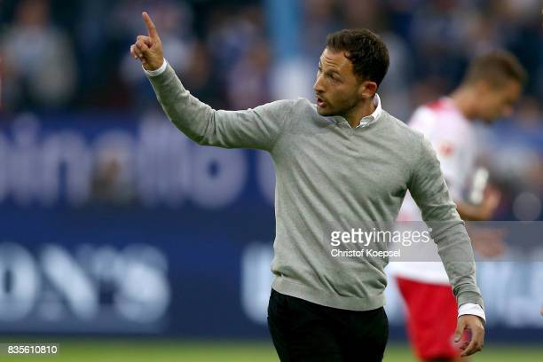 Head coach Domenico Tedesco issues instructions during the Bundesliga match between FC Schalke 04 and RB Leipzig at VeltinsArena on August 19 2017 in...