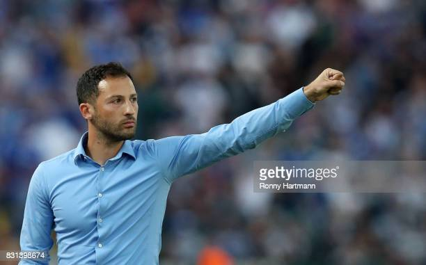 Head coach Domenico Tedesco of FC Schalke 04 celebrates during the DFB Cup first round match between BFC Dynamo and FC Schalke 04 at...