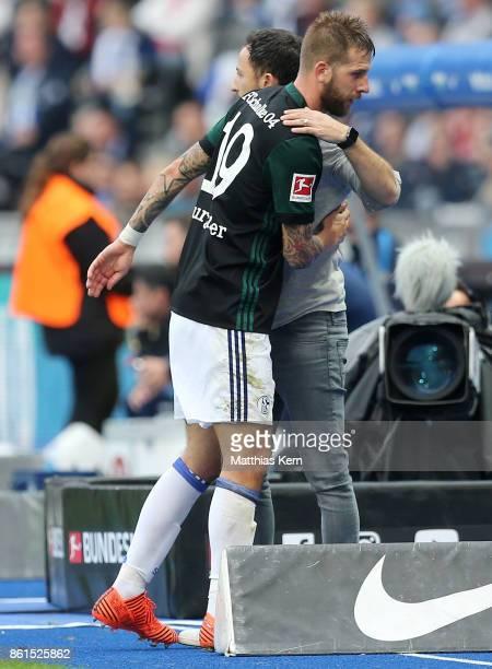 Head coach Domenico Tedesco of Schalke and Guido Burgstaller look on during the Bundesliga match between Hertha BSC and FC Schalke 04 at...