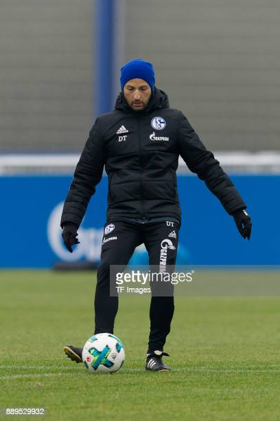 Head coach Domenico Tedesco of Schalke controls the ball during a training session at the FC Schalke 04 Training center on December 05 2017 in...