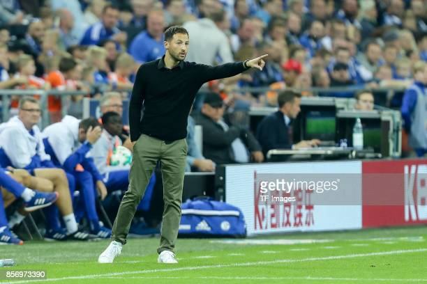 Head coach Domenico Tedesco of Schalke gestures during the Bundesliga match between FC Schalke 04 and Bayer 04 Leverkusen at VeltinsArena on...