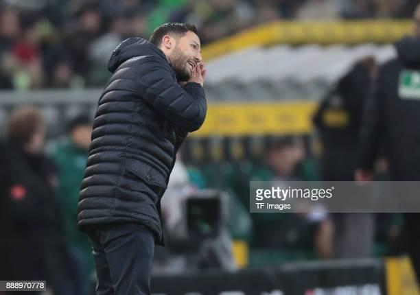 Head coach Domenico Tedesco of Schalke gestures during the Bundesliga match between Borussia Moenchengladbach and FC Schalke 04 at BorussiaPark on...
