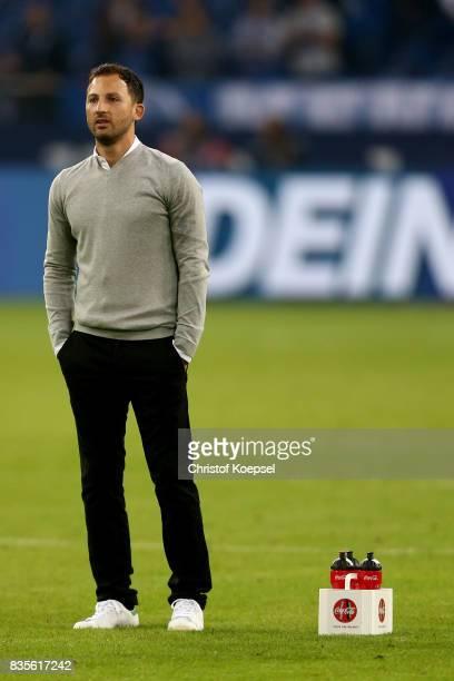 Head coach Domenico Tedesco of Schalke looks on after the Bundesliga match between FC Schalke 04 and RB Leipzig at VeltinsArena on August 19 2017 in...