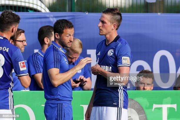 Head coach Domenico Tedesco of Schalke shakes hands with Bastian Oczipka of Schalke during the preseason friendly match between FC Schalke 04 and SD...