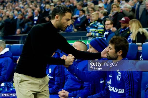 Head coach Domenico Tedesco of Schalke shakes hands with Coke of Schalke prior the Bundesliga match between FC Schalke 04 and Hamburger SV at...