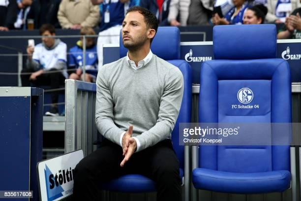 Head coach Domenico Tedesco of Schalke sits on the bench during the Bundesliga match between FC Schalke 04 and RB Leipzig at VeltinsArena on August...