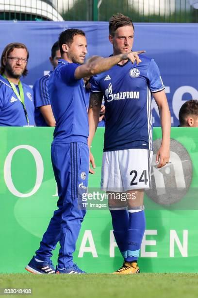 Head coach Domenico Tedesco of Schalke speak with Bastian Oczipka of Schalke during the preseason friendly match between FC Schalke 04 and SD Eibar...