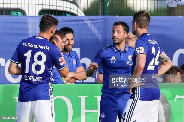 Head coach Domenico Tedesco of Schalke speak with Bastian Oczipka of Schalke and Daniel Caligiuri of Schalke during the preseason friendly match...