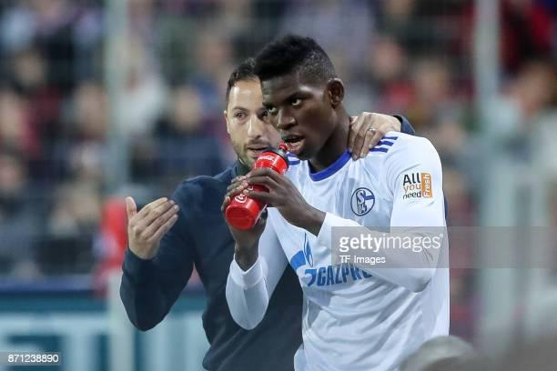 Head coach Domenico Tedesco of Schalke speak with Breel Embolo of Schalke during the Bundesliga match between SportClub Freiburg and FC Schalke 04 at...