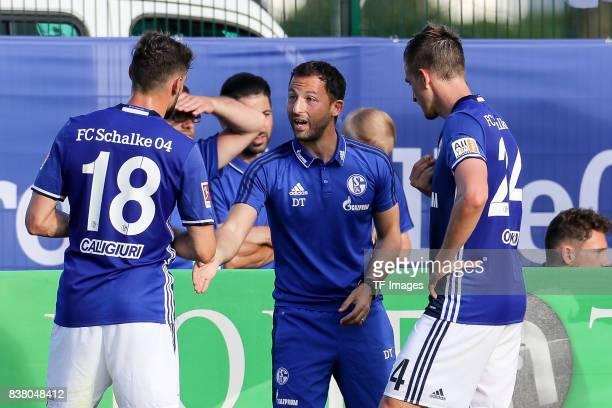 Head coach Domenico Tedesco of Schalke speak with Daniel Caligiuri of Schalke and Bastian Oczipka of Schalke during the preseason friendly match...
