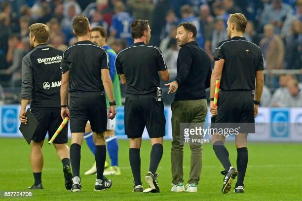 Head coach Domenico Tedesco of Schalke speak with referee Guido Winkmann during the Bundesliga match between FC Schalke 04 and Bayer 04 Leverkusen at...