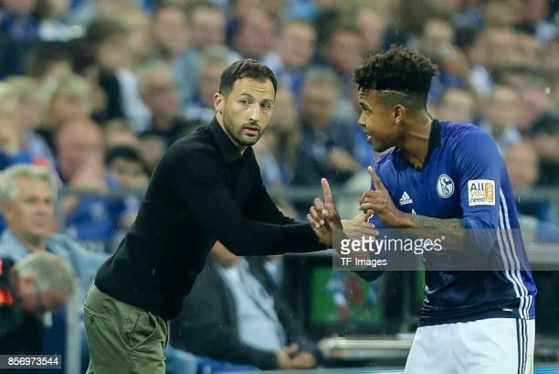 Head coach Domenico Tedesco of Schalke speak with Weston McKennie of Schalke during the Bundesliga match between FC Schalke 04 and Bayer 04...