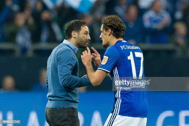 Head coach Domenico Tedesco of Schalke speaks with Benjamin Stambouli of Schalke during the Bundesliga match between FC Schalke 04 and 1 FSV Mainz 05...