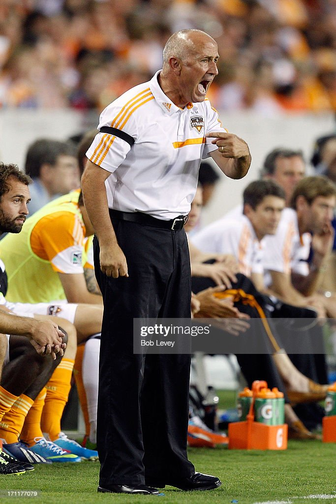 Head coach Dominic Kinnear of Houston Dynamo has words with the refereree against the Toronto FC at BBVA Compass Stadium on June 22, 2013 in Houston, Texas.