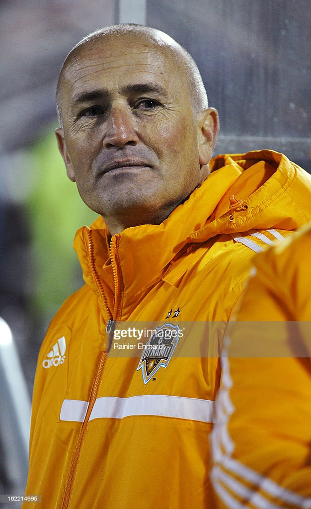 Head coach Dominic Kinnear of the Houston Dynamo looks on during the second half of a game against the Vancouver Whitecaps FC on February 20, 2013 in Charleston, North Carolina.