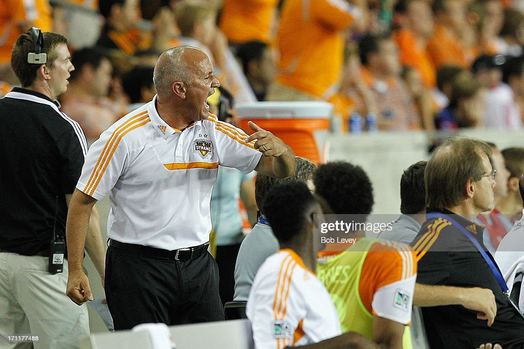 Head coach Dominic Kinnear of the Houston Dynamo reacts to the referee's call on the field against the Toronto FC at BBVA Compass Stadium on June 22, 2013 in Houston, Texas.