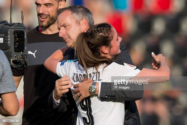 Head coach Dominik Thalhammer of Austria and Sarah Zadrazil of Austria celebrate their win during the Group C match between Austria and Switzerland...