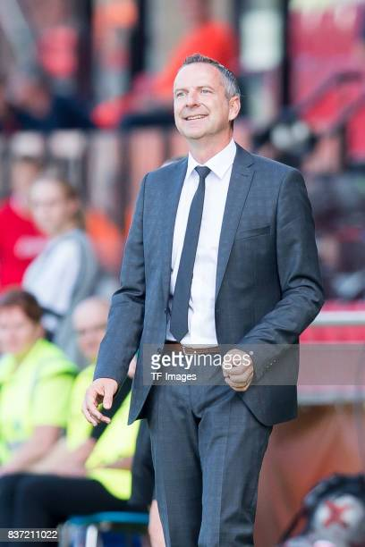 Head coach Dominik Thalhammer of Austria laughs during the Group C match between Austria and Switzerland during the UEFA Women's Euro 2017 at Stadion...