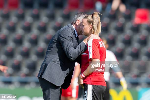 Head coach Dominik Thalhammer of Austria speak with Virginia Kirchberger of Austria during the Group C match between Austria and Switzerland during...