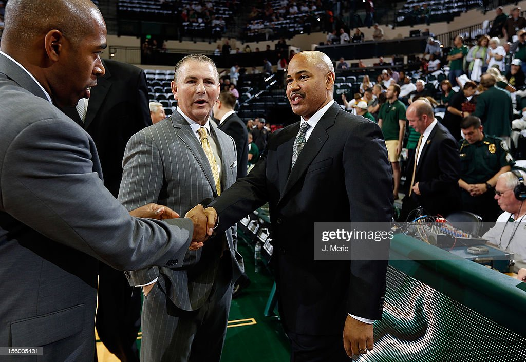 Head coach Donnie Jones (L) of the Central Florida Knights and head coach Stan Heath of the South Florida Bulls shake hands before the game at the Sun Dome on November 10, 2012 in Tampa, Florida.