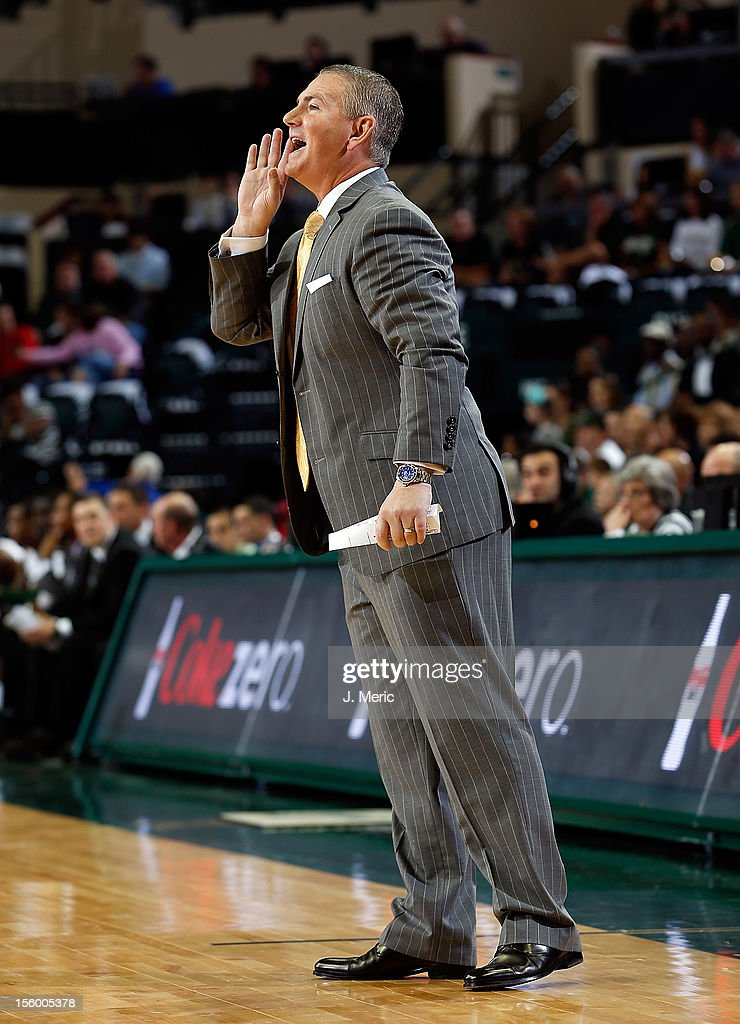 Head coach Donnie Jones of the Central Florida Knights directs his team against the South Florida Bulls during the game at the Sun Dome on November 10, 2012 in Tampa, Florida.