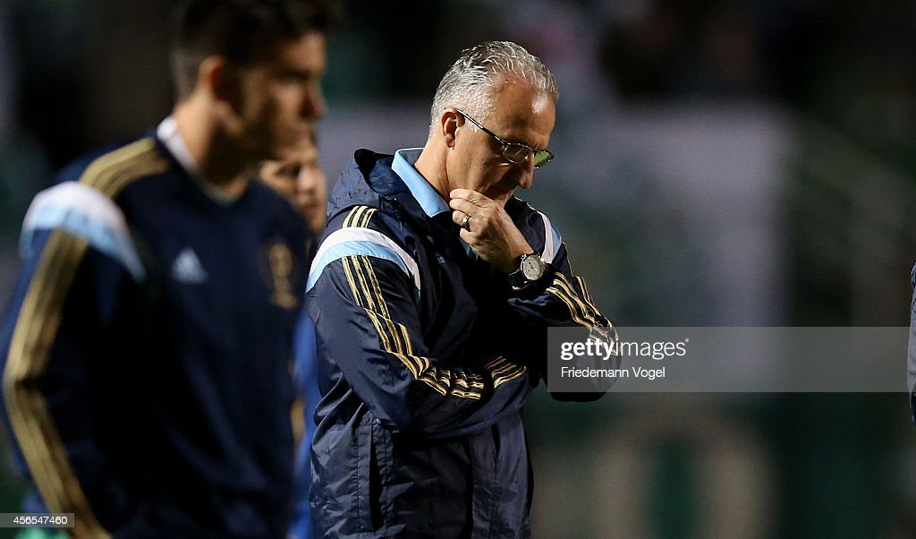 Head coach Dorival Junior of Palmeiras walks of dejected during the match between Palmeiras and Chapecoense for the Brazilian Series A 2014 at...
