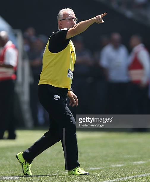 Head coach Dorival Junior of Santos gives advise during the match between Corinthians and Santos for the Brazilian Series A 2015 at Arena Corinthians...
