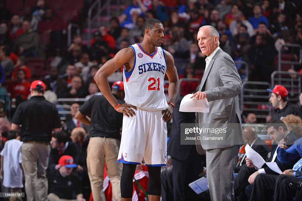 Head Coach Doug Collins and Thaddeus Young #21 of the Philadelphia 76ers talk during a break in play against the New Orleans Hornets at the Wells Fargo Center on January 15, 2013 in Philadelphia, Pennsylvania.