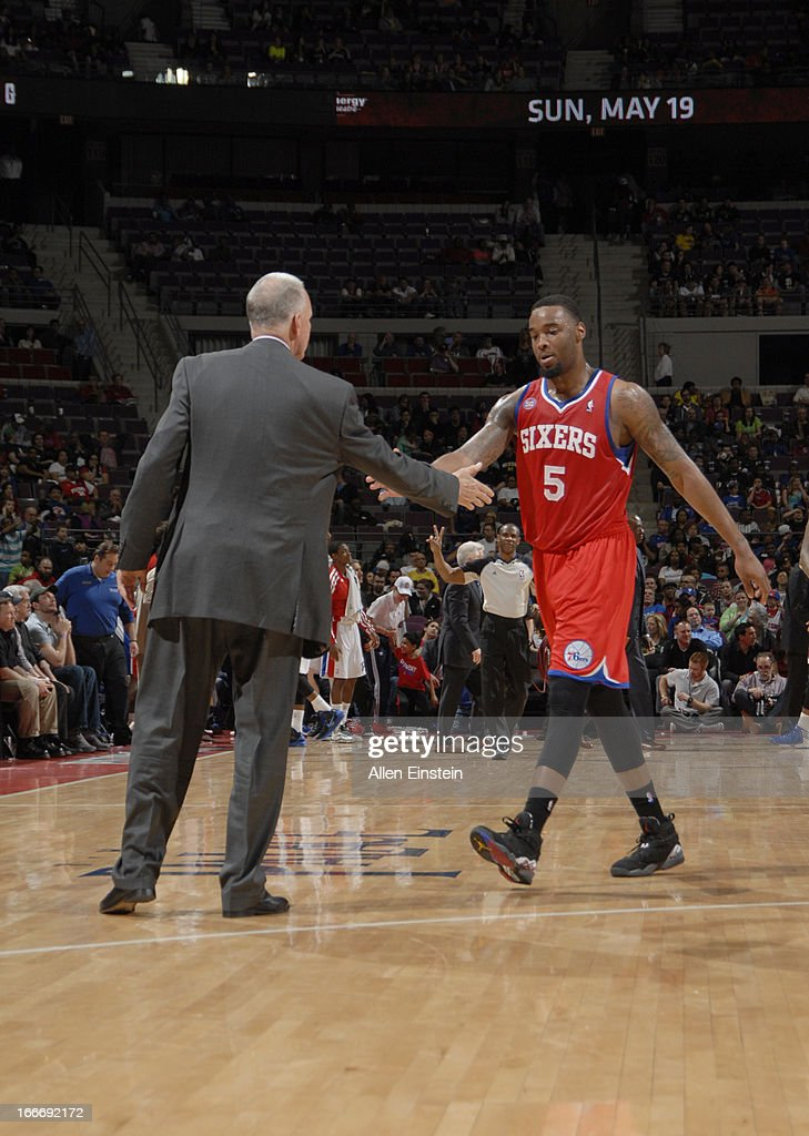 Head Coach Doug Collins of the Philadelphia 76ers congratulates Arnett Moultrie #5 of the Philadelphia 76ers during the game between the Detroit Pistons and the Philadelphia 76ers on April 15, 2013 at The Palace of Auburn Hills in Auburn Hills, Michigan.