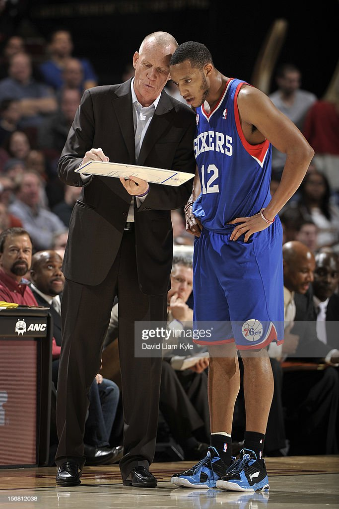 Head coach <a gi-track='captionPersonalityLinkClicked' href=/galleries/search?phrase=Doug+Collins&family=editorial&specificpeople=238972 ng-click='$event.stopPropagation()'>Doug Collins</a> of the Philadelphia 76ers discusses a play with <a gi-track='captionPersonalityLinkClicked' href=/galleries/search?phrase=Evan+Turner&family=editorial&specificpeople=4665764 ng-click='$event.stopPropagation()'>Evan Turner</a> #12 during a break in the action against the Cleveland Cavaliers at The Quicken Loans Arena on November 21, 2012 in Cleveland, Ohio.