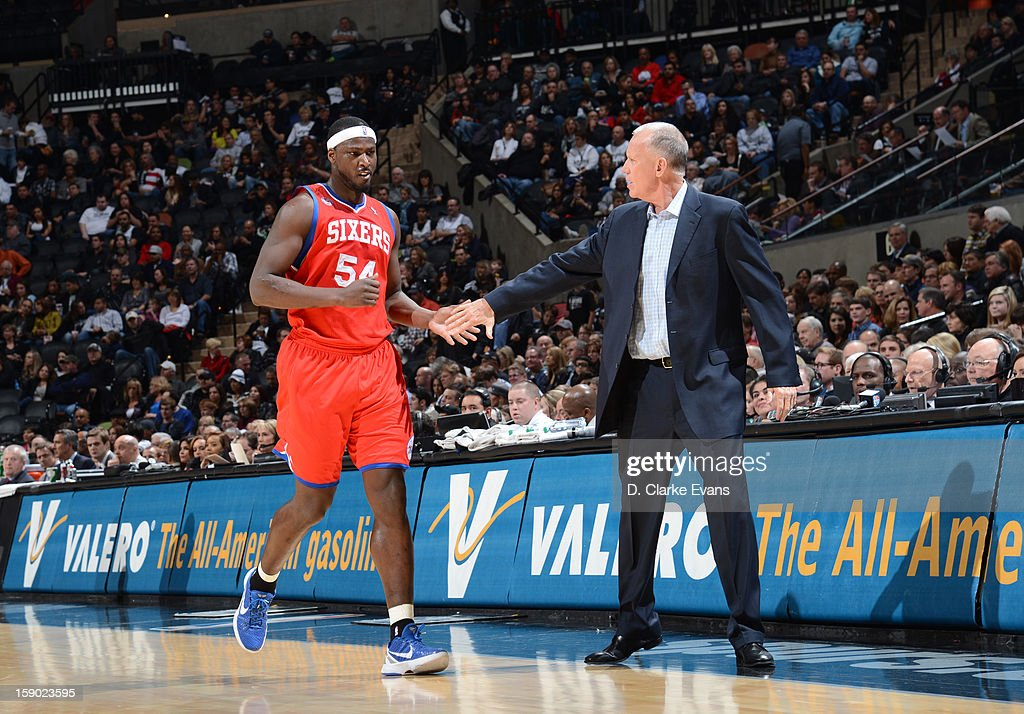 Head Coach <a gi-track='captionPersonalityLinkClicked' href=/galleries/search?phrase=Doug+Collins&family=editorial&specificpeople=238972 ng-click='$event.stopPropagation()'>Doug Collins</a> of the Philadelphia 76ers encourages <a gi-track='captionPersonalityLinkClicked' href=/galleries/search?phrase=Kwame+Brown&family=editorial&specificpeople=201536 ng-click='$event.stopPropagation()'>Kwame Brown</a> #54 of the Philadelphia 76ers during the game between the Philadelphia 76ers and the San Antonio Spurs on January 5, 2013 at the AT&T Center in San Antonio, Texas.