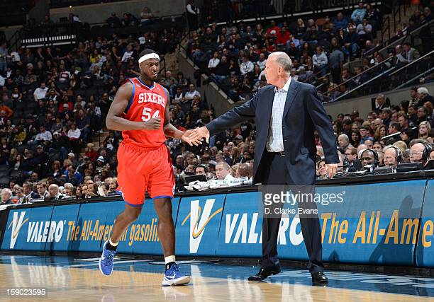 Head Coach Doug Collins of the Philadelphia 76ers encourages Kwame Brown of the Philadelphia 76ers during the game between the Philadelphia 76ers and...