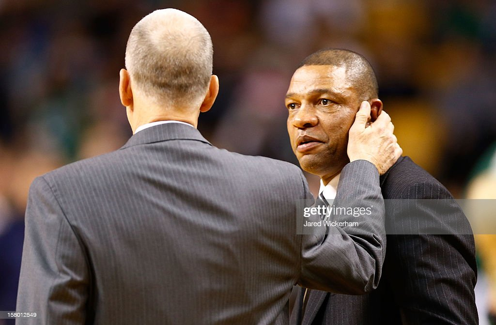 Head coach Doug Collins of the Philadelphia 76ers greets head coach Doc Rivers of the Boston Celtics during the game on December 8, 2012 at TD Garden in Boston, Massachusetts.