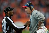 Head coach Doug Marrone of the Buffalo Bills has a word with field judge Barry Anderson at Sports Authority Field at Mile High on December 7 2014 in...