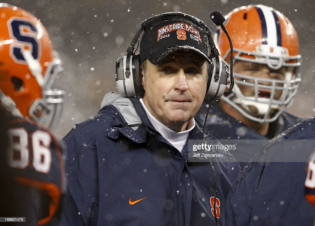 Head coach Doug Marrone of the Syracuse Orange works on the sidelines against the West Virginia Mountaineers in the New Era Pinstripe Bowl at Yankee Stadium on December 29, 2012 in the Bronx borough of New York City.