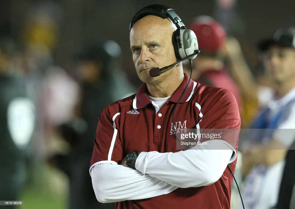 Head coach Doug Martin of the New Mexico State Aggies looks on during the game with the UCLA Bruins at the Rose Bowl on September 21, 2013 in Pasadena, California. UCLA won 59-13.