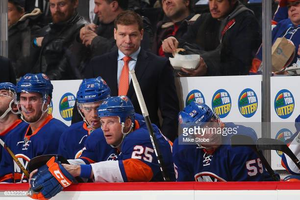 Head Coach Doug Weight of the New York Islanders looks on from the bench against the Washington Capitals at the Barclays Center on January 31 2017 in...