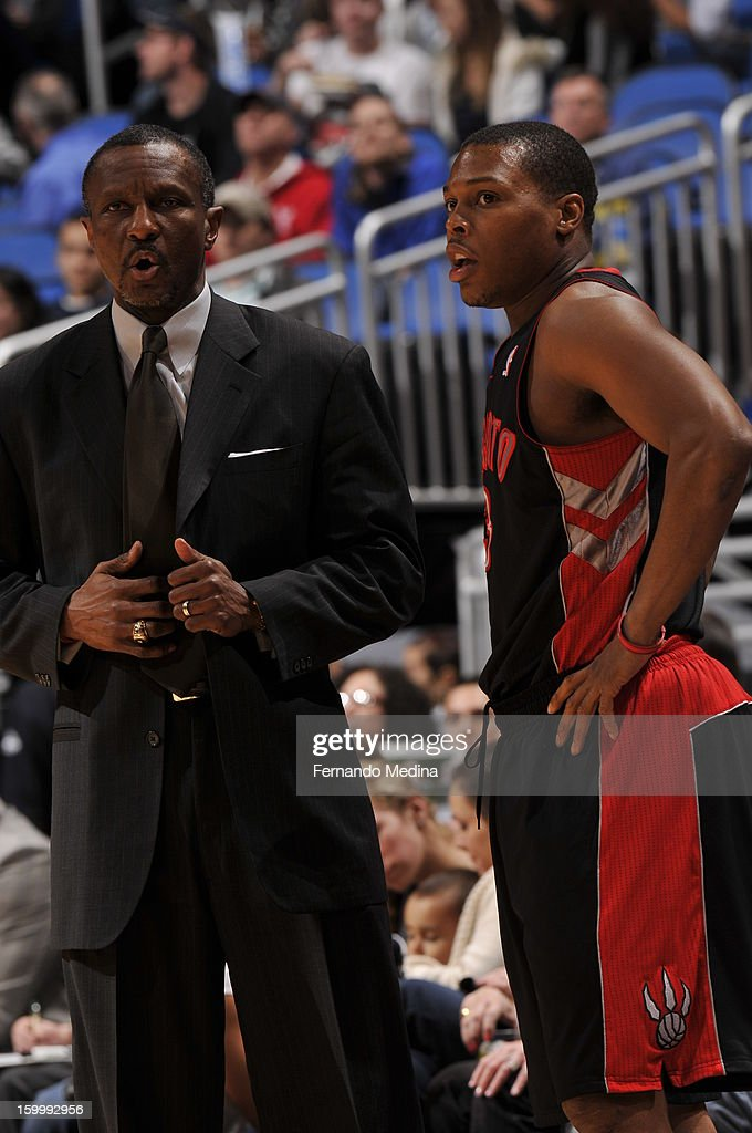 Head Coach Dwane Casey and Kyle Lowry of the Toronto Raptors have a conversation on the sidelines against the Orlando Magic during the game on January 24, 2013 at Amway Center in Orlando, Florida.
