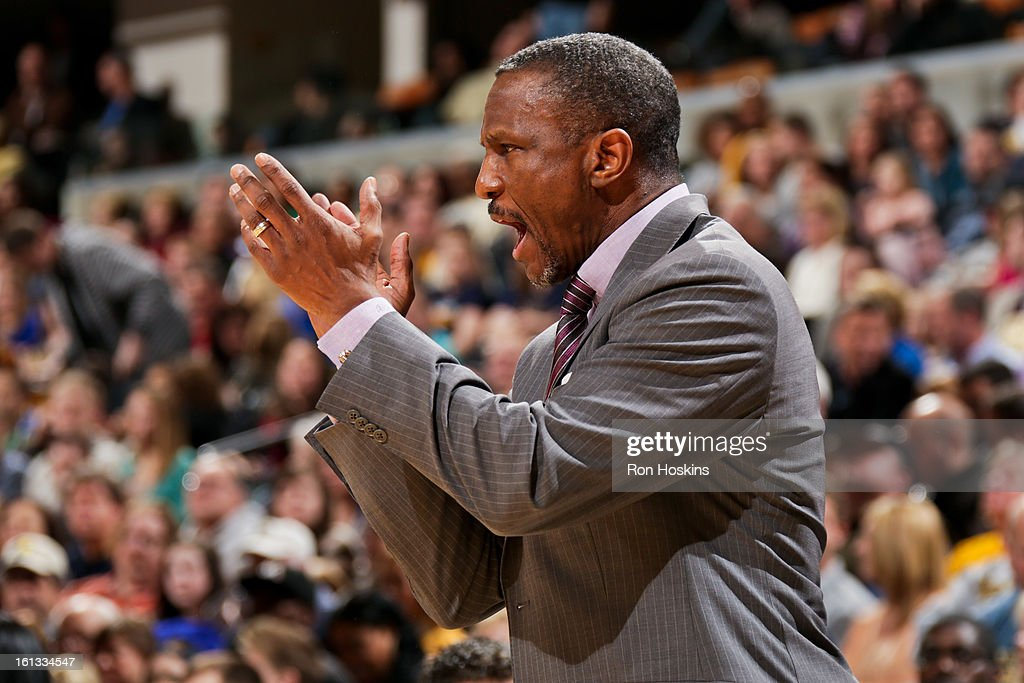 Head Coach Dwane Casey of the Toronto Raptors applauds his team against the Indiana Pacers on February 8, 2013 at Bankers Life Fieldhouse in Indianapolis, Indiana.