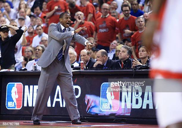 Head coach Dwane Casey of the Toronto Raptors argues a call in the first quarter against the Cleveland Cavaliers in game six of the Eastern...