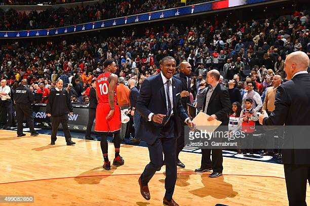 Head Coach Dwane Casey of the Toronto Raptors cheers after winning the game with a last second shot during the game against the Washington Wizards on...