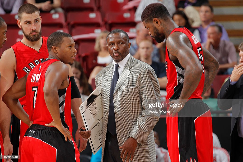Head Coach Dwane Casey of the Toronto Raptors coaches against the Sacramento Kings on October 7 2014 at Sleep Train Arena in Sacramento California...