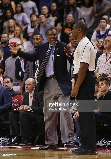 Head coach Dwane Casey of the Toronto Raptors gestures to the referee during an NBA game against the New York Knicks at the Air Canada Centre on...