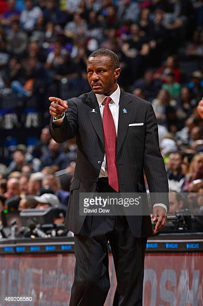 Head Coach Dwane Casey of the Toronto Raptors looks on while wearing his Autism Awareness Pin against the Brooklyn Nets at Barclays Center on April 3...