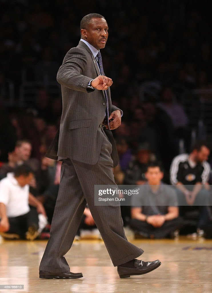 Head coach Dwane Casey of the Toronto Raptors signals during the game against the Los Angeles Lakers at Staples Center on November 30 2014 in Los...