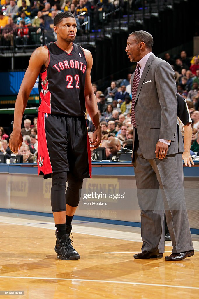 Head Coach Dwane Casey of the Toronto Raptors speaks to Rudy Gay #22 during a game against the Indiana Pacers on February 8, 2013 at Bankers Life Fieldhouse in Indianapolis, Indiana.